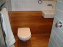 Teak floor and panelling with wall hung toilet